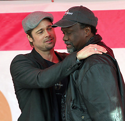 Dec 03 2007. New Orleans, Louisiana. Lower 9th Ward.<br /> Brad Pitt revisits the Lower 9th ward, devastated by Hurricane Katrina to present 'Make it Right' where architects' designs are unveiled to the public. Brad on stage gives a passionate  presentation to the press and public. Brad and local resident Robert Green, local advocate who lost his mother and grandaughter to the storm.<br /> Photo credit; Charlie Varley.