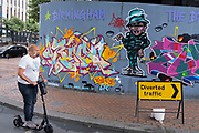 As numbers of Covid-19 cases in Birmingham have increased dramatically in recent weeks, and with the expectation that the city will be added to the watch list of critical areas which may face a local lockdown, people wearing face masks pass Birmingham street art graffiti in the city centre on 18th August 2020 in London, United Kingdom. With other areas in the Midlands under localised lockdown, people and businesses are being urged to follow the Coronavirus advice for workplace and family life help reduce the risk.