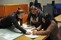 Christina Connery, left, goes over census tract maps with volunteers at the 2017 Point-In-Time Homeless Count and Survey conducted by the Coalition of Homeless Service Providers in Salinas early Wednesday morning, Jan. 25th.