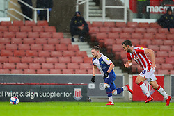 Harvey Elliott of Blackburn Rovers charges down the right wing, pursued by Morgan Fox of Stoke City - Mandatory by-line: Nick Browning/JMP - 19/12/2020 - FOOTBALL - Bet365 Stadium - Stoke-on-Trent, England - Stoke City v Blackburn Rovers - Sky Bet Championship