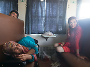 Aïgul (in red) travels with her mother back to Yarkand, after visiting relatives in Hotan.