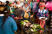 Zapotec women in traditional dress grill meat and vegetables at the large weekly market of Tlacolula, Oaxaca state, Mexico on July 20, 2008.