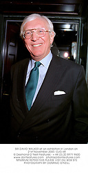 SIR DAVID WALKER at an exhibition in London on 21st November 2000.OJG 68