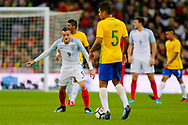 England Leicester City forward Jamie Vardy (9) has an eye on Brazil Real Madrid midfielder Casemiro (5)  during the International Friendly match between England and Brazil at Wembley Stadium, London, England on 14 November 2017. Photo by Simon Davies.