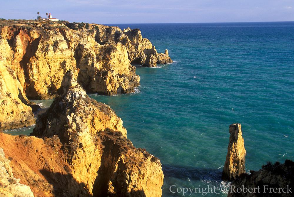 PORTUGAL, ALGARVE, SOUTH COAST Ponta de Piedade, rocky peninsula with lighthouse jutting into the sea just south of Lagos
