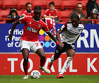 LONDON, ENGLAND - SEPTEMBER 25: Pape Souaré of Charlton Athletic and Mahlon Romeo of Portsmouth during the Sky Bet League One match between Charlton Athletic and Portsmouth at The Valley on September 25, 2021 in London, England. (Photo by Ben Peters/MB Media)