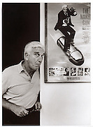 Actor Leslie Nielsen poses for a portrait next his his movie poster of the Naked Gun. Photo by Scott Iskowitz