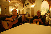 """Guitar players Jose Carvalhinho (left) and Manuel Mendes (right) perform every night at the restaurant """"Marques da Se"""", one of the main Fado venues in Lisbon."""