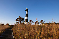 NC00716-00...NORTH CAROLINA...Sunrise at Bodie Island Lighthouse in Cape Hatteras National Seashore on the Outer Banks.