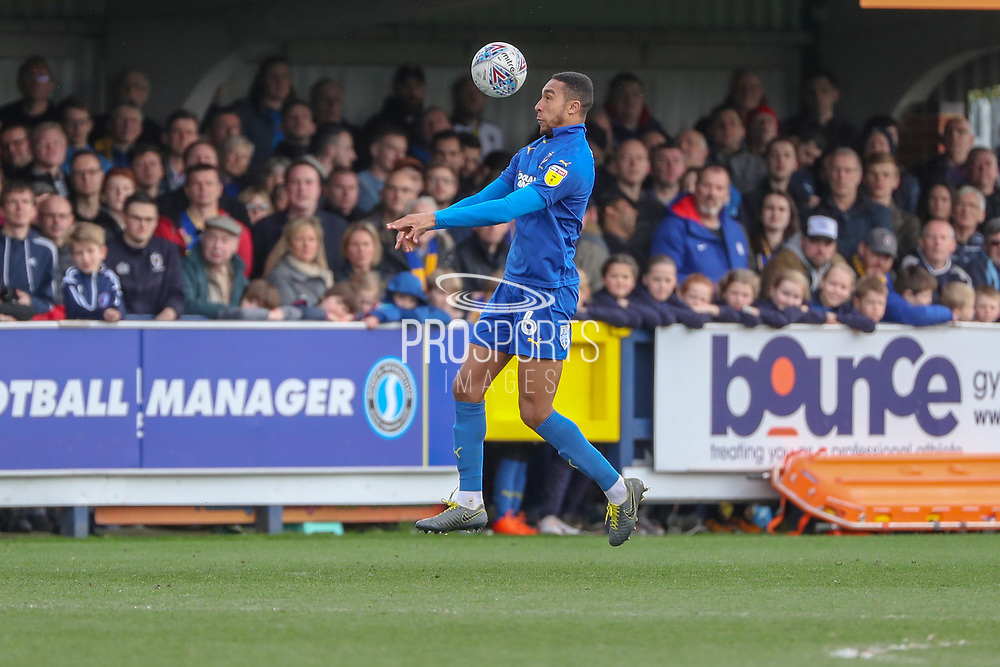 AFC Wimbledon defender Terell Thomas (6) heading the ball during the EFL Sky Bet League 1 match between AFC Wimbledon and Gillingham at the Cherry Red Records Stadium, Kingston, England on 23 March 2019.