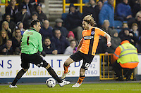 Brighton & Hove Albion's Craig Mackail-Smith attempts to nutmeg Millwall's David Forde but fails to convert the chance<br /> <br /> Photographer Craig Mercer/CameraSport<br /> <br /> Football - The Football League Sky Bet Championship - Millwall v Brighton and Hove Albion - Tuesday 17th March 2015 - The Den - London<br /> <br /> © CameraSport - 43 Linden Ave. Countesthorpe. Leicester. England. LE8 5PG - Tel: +44 (0) 116 277 4147 - admin@camerasport.com - www.camerasport.com