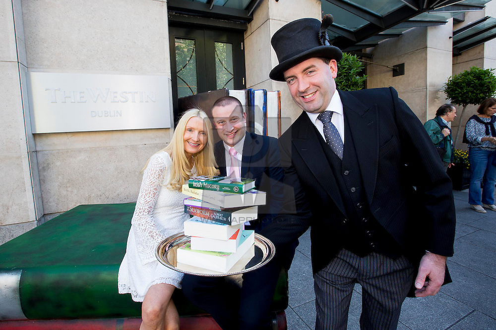 Repro Free: 23/06/2105 Author and actress Claudia Carroll pictured with John Keane manager of Eason O'Connell Street at the launch of The Book Butler @ The Westin Dublin, a service which allows guests to choose from a hand-picked list of books from the top ten genres most likely to appeal, as recommended by the hotels partner, Eason ensuring that guests of the hotel enjoy a truly personalised literary experience. This marries perfectly with the hotels ethos of inspiring guests to discover new approaches to well-being at Westin Hotels. Claudia Carroll latest book Meet Me in Manhattan is available now in Eason stores nationwide. Picture Andres Poveda
