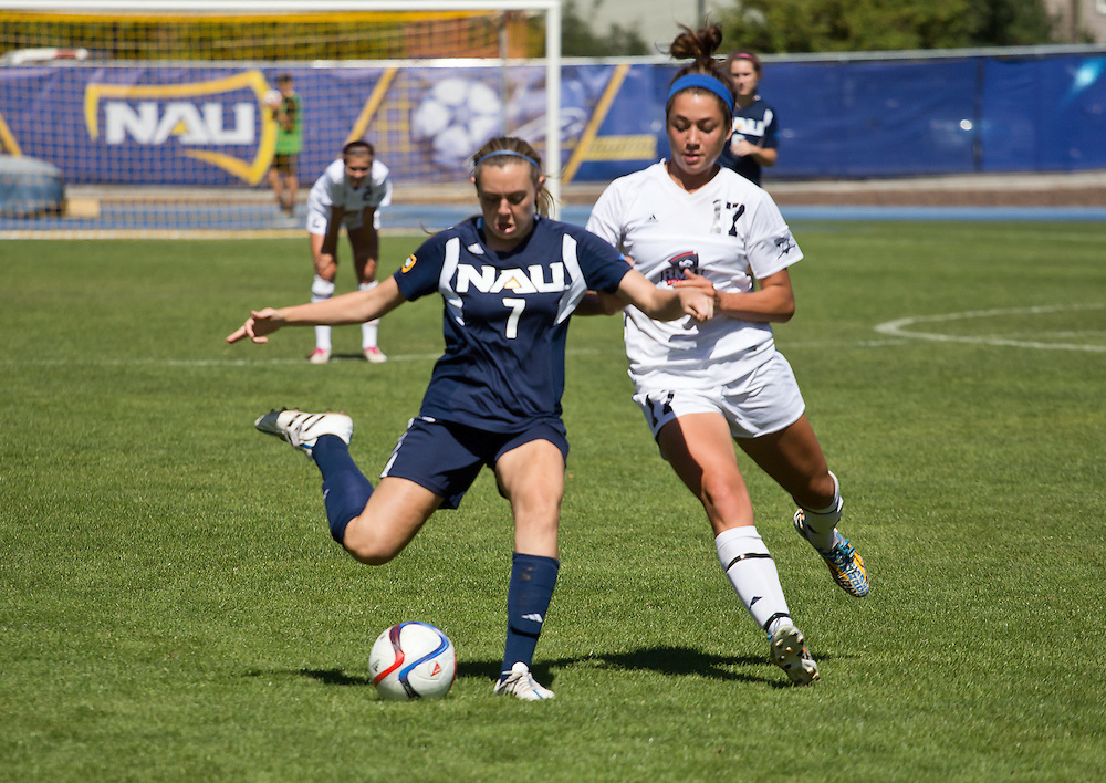 NAU's midfielder Cierra Gamble (Sr.) controls the ball as she battles off RMU's Greer Monahan (So.) during the NAU's soccer game on Sunday, Sept. 20, 2015. Gamble would get rid of the ball by kicking it to one of NAU's forwards, who would later add to the 3-0 lead at the start of the second half. (Photo by David Carballido-Jeans)