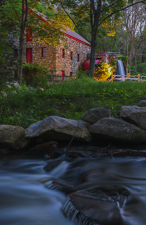 The Wayside Inn Grist Mill in Sudbury Massachusetts on a beautiful spring night in summer. A long exposure photography setting conveys the flowing water of the brook in the front and the falling waters across the Grist Mill.<br /> <br /> Sudbury Grist Mill photography images are available as museum quality photo, canvas, acrylic, wood or metal prints. Wall art prints may be framed and matted to the individual liking and interior design decoration needs:<br /> <br /> https://juergen-roth.pixels.com/featured/old-grist-mill-at-wayside-inn-historic-district-juergen-roth.html<br /> <br /> Good light and happy photo making!<br /> <br /> My best,<br /> <br /> Juergen<br /> Licensing: http://www.rothgalleries.com<br /> Photo Prints: http://fineartamerica.com/profiles/juergen-roth.html<br /> Photo Blog: http://whereintheworldisjuergen.blogspot.com<br /> Instagram: https://www.instagram.com/rothgalleries<br /> Twitter: https://twitter.com/naturefineart<br /> Facebook: https://www.facebook.com/naturefineart