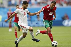 (l-r) Morteza Pouraliganji of IR Iran, Aziz Bouhaddouz of Morocco