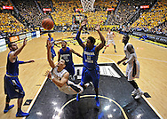 WICHITA, KS - JANUARY 18:  Guard Fred VanVleet #23 of the Wichita State Shockers puts up a diving shot past defenders Devonte Brown #11 and Khristian Smith #32 of the Indiana State Sycamores during the second half on January 18, 2014 at Charles Koch Arena in Wichita, Kansas.  Wichita State defeated Indiana State 68-48. (Photo by Peter Aiken/Getty Images) *** Local Caption *** Fred VanVleet;Devonte Brown;Khristian Smith