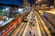 Haifa Train station at night. Haifa port in the background. Haifa, Israel