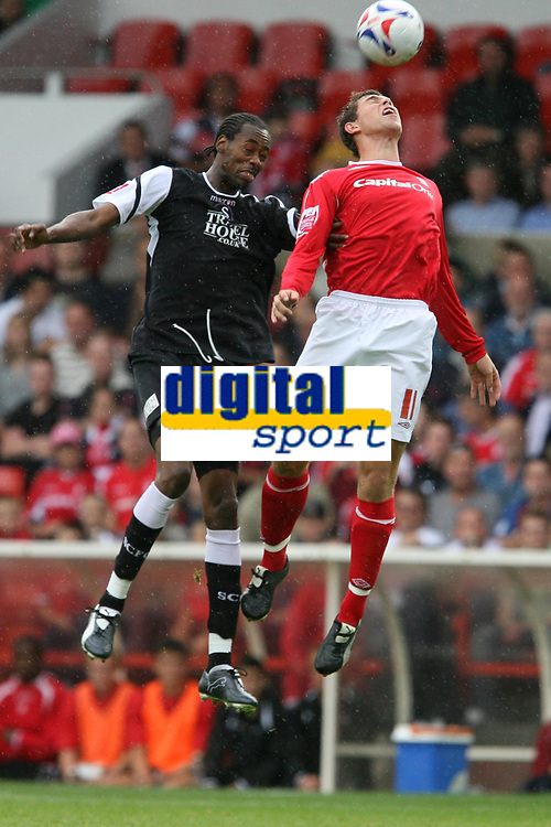 Photo: Pete Lorence.<br />Nottingham Forest v Swansea City. Coca Cola League 1. 30/09/2006.<br />Dennis Lawrence leaps for the ball, but Grant Holt out-jumps him.