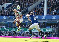 Burnley's Sam Vokes out jumps Everton's Gareth Barry but heads wide of the goal<br /> <br /> Photographer Stephen White/CameraSport<br /> <br /> Football - Barclays Premiership - Everton v Burnley - Saturday 18th April 2015 - Goodison Park - Everton<br /> <br /> © CameraSport - 43 Linden Ave. Countesthorpe. Leicester. England. LE8 5PG - Tel: +44 (0) 116 277 4147 - admin@camerasport.com - www.camerasport.com