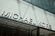 Sign for the luxury clothing brand Michael Kors in Birmingham, United Kingdom.