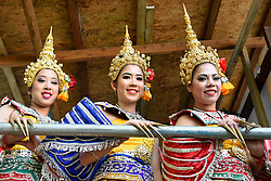 © Licensed to London News Pictures. 09/04/2017. London, UK.  Dancers in traditional costume backstage ahead of a performance.  Worshippers and visitors attend the Thai New Year festival of Songkran at The Buddhapadipa Temple in Wimbledon.  Traditionally, the sprinkling of water symbolises the washing away of the past, and water would have been gently poured onto elders, or images of Buddha.
