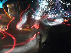 Blurry, streaked lights of traffic on Mysore street at night.