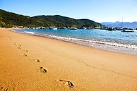 footstep on the sand of abraao beach in the beautiful island of ilha grande near rio de janeiro in brazil