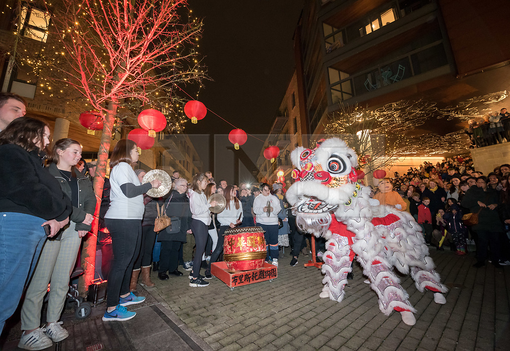 © Licensed to London News Pictures. 25/01/2020. Bristol, UK. Chinese New year celebrations at WokyFest 2020 at Wapping Wharf on Bristol Harbourside. The year 2020 marks the year of the Rat, the first of the 12-year cycle of animals which appear in the Chinese Zodiac; the Rat is highly revered for its adaptability, intelligence, positivity and cunning. The event celebrates Chinese New Year with a day of food, music and traditional Chinese New style year celebrations including the traditional lion dance with the University of Bristol Chinese Lion Dance Troupe. 2020 marks the fourth year of WokyFest, created by Larkin Cen, Chef/Owner of three Woky Ko restaurants in Bristol and a Woky Ko street food stall in St Nicholas Market, Bristol. Photo credit: Simon Chapman/LNP.