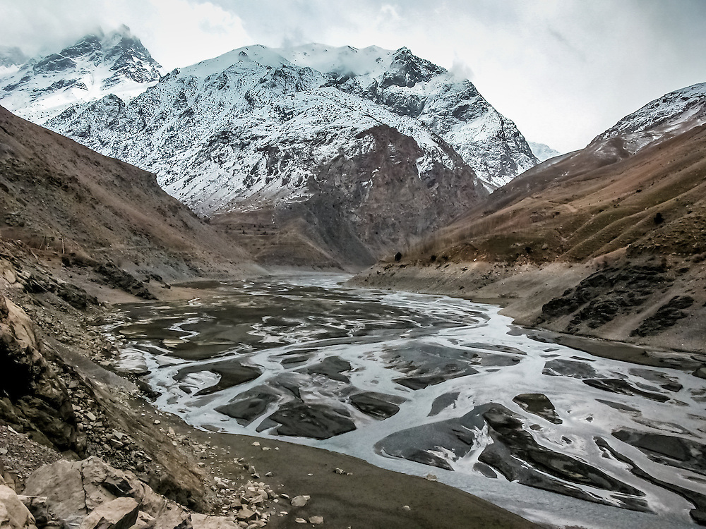 Stock landscape photograph of the braided river section of the upper Fourth Lake, one of the Seven Lakes in the Shing Valley of Tajikistan