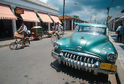 CUBA, ISLE OF YOUTH Nueva Gerona, main street, with classic pre-revolutionary American car