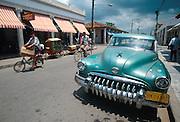 CUBA, ISLE OF YOUTH Nueva Gerona, main street, with classic pre-revolutionary American car