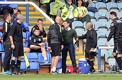 Oldham Athletic's manager Lee Johnson argues with Peterborough United's goalkeeper coach Jimmy Walker on the touchline during the game  - Photo mandatory by-line: Joe Dent/JMP - Tel: Mobile: 07966 386802 17/08/2013 - SPORT - FOOTBALL - London Road Stadium - Peterborough -  Peterborough United V Oldham Athletic - Sky Bet League One