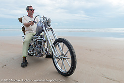 Bill Buckingham with his 1923 Harley-Davidson J model custom chopper (that won top honors at Born Free 6) on the sands of Daytona Beach for the official start and stage Stage 1 of the Motorcycle Cannonball Cross-Country Endurance Run, which on this day ran from Daytona Beach to Lake City, FL., USA. Friday, September 5, 2014.  Photography ©2014 Michael Lichter.
