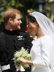 File photo dated 19/05/2018 of The Duke and Duchess of Sussex outside St George's Chapel as Meghan clutches her wedding bouquet as Princess Eugenie is expected to follow tradition by including a floral good luck charm in her wedding bouquet.