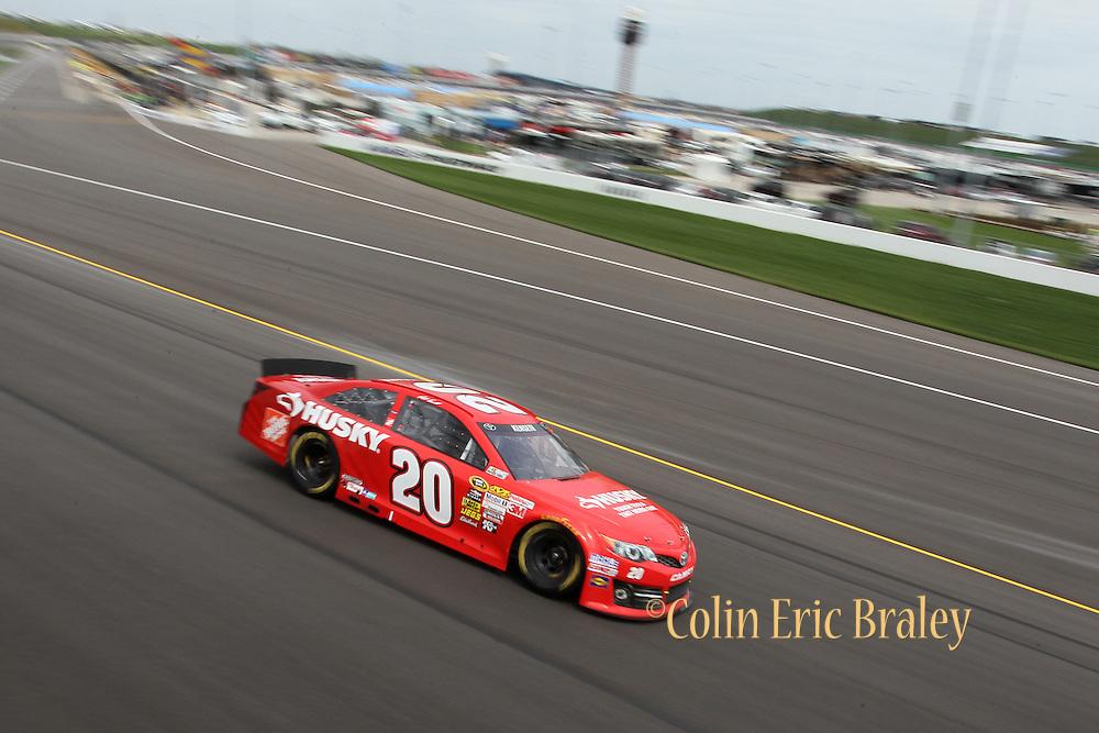 Matt Kenseth drives the Toyota (20) car during a NASCAR Sprint Cup race at Kansas Speedway, Sunday, April 21, 2013 in Kansas City, Kansas. (AP Photo/Colin E. Braley)