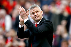 Manchester United caretaker manager Ole Gunnar Solskjaer applauds the fans during the Premier League match at Old Trafford, Manchester.