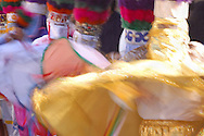 """Bolivia. Tarija.  San Roque feast.They dance in front of the saint, in pairs of men only, cloaks flutter. They are the """"Chunchos"""", the masks are typical of Tarija in southern Bolivia, where the festival dedicated to """"San Roque"""" lasts two weeks between August and September."""