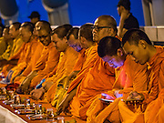 05 DECEMBER 2016 - BANGKOK, THAILAND:  Buddhist monks on Bhumibol Bridge before a ceremony honoring the late King of Thailand. Tens of thousands of Thais gathered on Bhumibol Bridge in Bangkok Monday to mourn the death of Bhumibol Adulyadej, the Late King of Thailand. The King died on Oct 13 after a lengthy hospitalization. December 5 is his birthday and a national holiday in Thailand. The bridge is named after the late King, who authorized its construction. 999 Buddhist monks participated in a special merit making ceremony on the bridge.      PHOTO BY JACK KURTZ