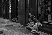 A street dweller wears a mask to protect himself from the Covid-19 on a street in downtown São Paulo. With the arrival of the pandemic, most of the social organizations that provided food for this population stopped circulating, as well as the pedestrians, who also provided some charity. As a result, people on the streets have suffered to be able to eat at least once a day.<br /> In a country as unequal as Brazil, the impacts of the Covid-19 pandemic on the population have been devastating, especially in the most vulnerable sections of society living in precarious conditions.
