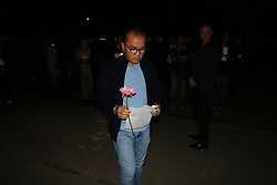 March 16, 2019 - Christchurch, New Zealand - Indonesian Ambassador Tantowi Yahya who have just flown in from Wellington seen holding a flower in his hand while paying respect to the victims of the Christchurch mosques shooting. Around 50 people has been reportedly killed a terrorist attack on two Christchurch mosques. (Credit Image: © Adam Bradley/SOPA Images via ZUMA Wire)