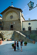 Tourists by Tuscan Church of San Niccolo, Chiesa San Niccolo, in Piazza Francesco Ferrucci in Radda-in-Chianti, Tuscany, Italy