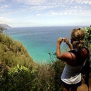 KAUAI, HI, July 12, 2007: Hikers explore the Kalalau Trail, one of Hawaii's most famous hikes on the North Shore of Kauai in Hawaii. The trail runs 11 miles along the Na Pali coast and provides amazing views.