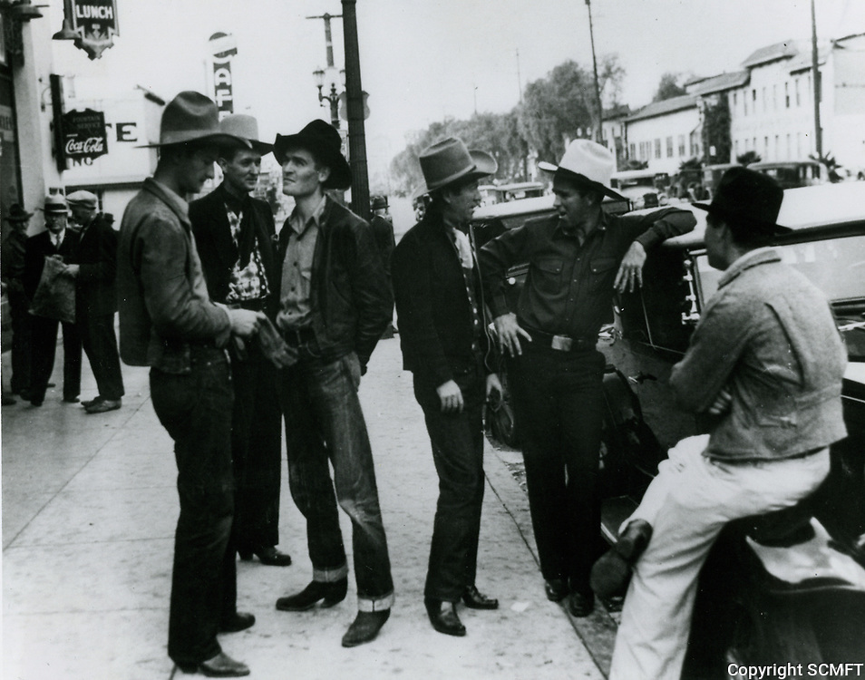 1933 Movie extra cowboys outside studios on Sunset Blvd. at Gower St. This area was known as Gower Gulch