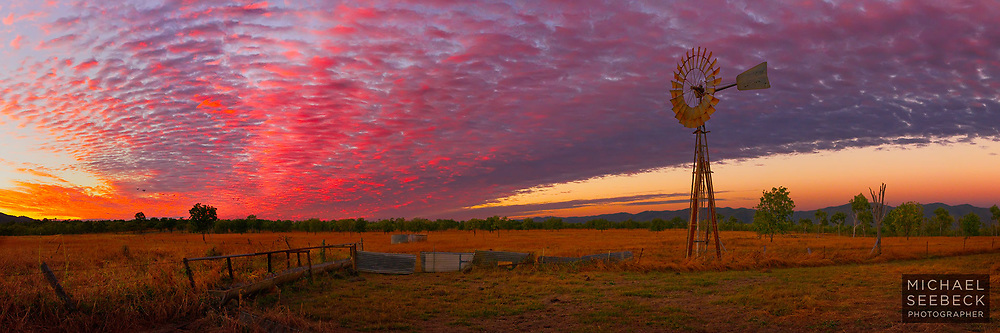 Vivid sunrise over a solitary windmill on a cattle property on Cape York Peninsula.<br /> <br /> Code: HAQP0002<br /> <br /> Limited Edition Print