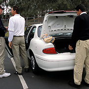 """Jerry Schneider, aka """"Scraper"""", moves in for the """"swoop"""" with PGA Tour player Steve Jones in the parking lot at the Buick Invitational in San Diego despite the fact that Jones was already set with his caddy."""