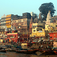 Asia, India, Varanasi.Boats on the Ganges River at Varanasi, a spiritual center for mysticism.