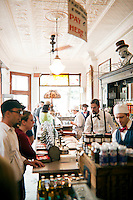 Owners and soda jerks alike serve customers at The Franklin Fountain in the historic Old City neighborhood of Philadelphia.