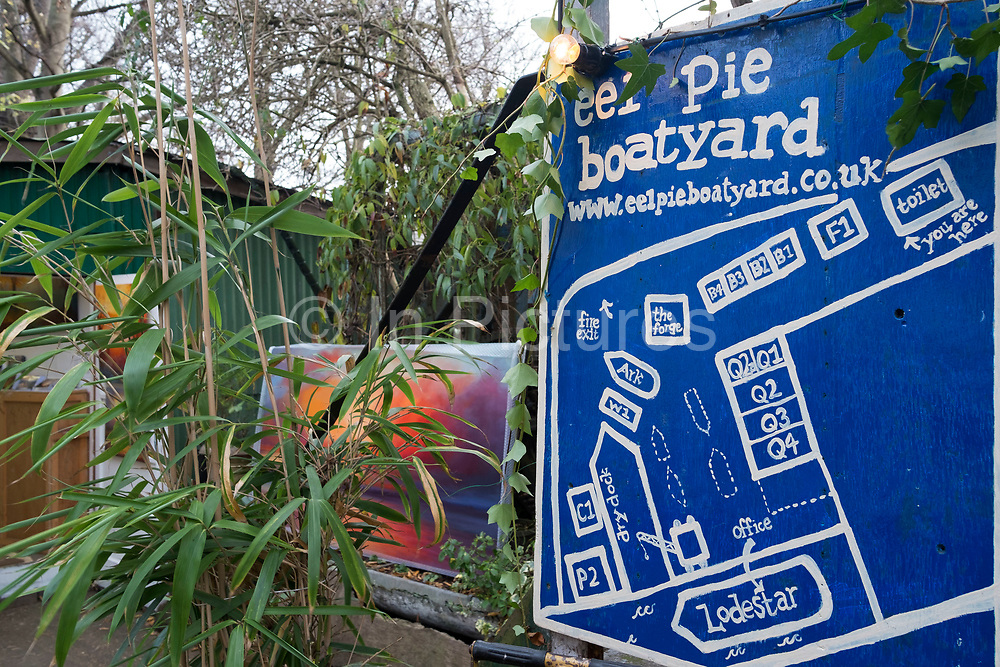Boatyard on Eel Pie Island in London, England, United Kingdom. Eel Pie Island is a small island in the River Thames at Twickenham in the London Borough of Richmond upon Thames and is only accessible by boat or by footbridge. The island has about 50 homes, 120 inhabitants, two or three boatyards as well as some other small businesses and artists studios. It has nature reserves at either end, protected from public access.