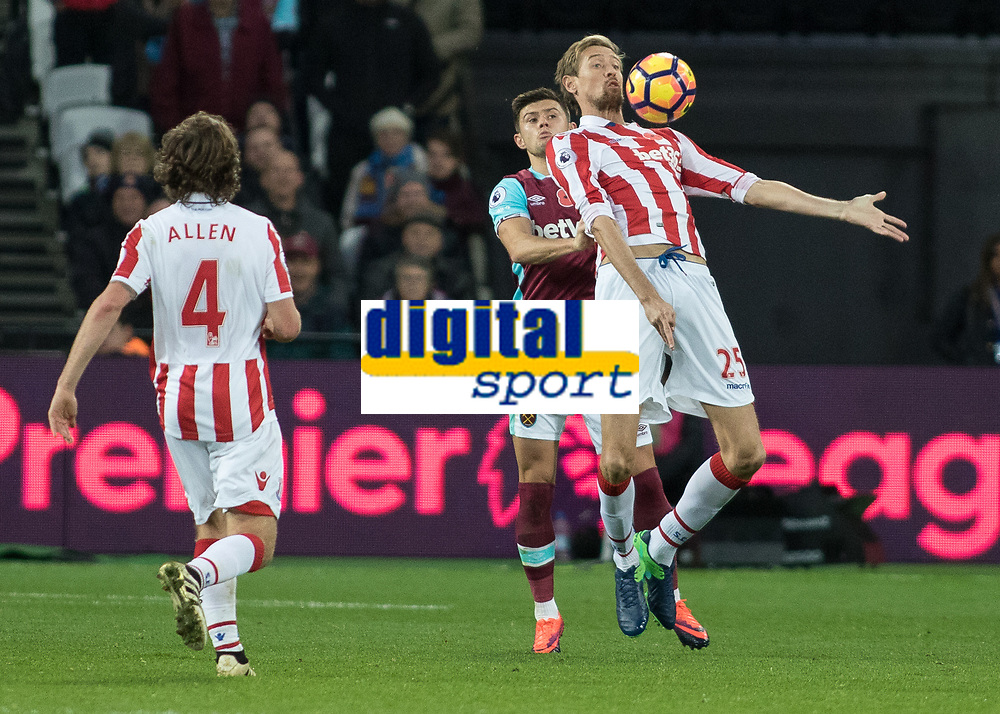 Football - 2016 / 2017 Premier League - West Ham United vs. Stoke City<br /> <br /> Peter Crouch of Stoke City brings the ball under control with his chest at The London Stadium.<br /> <br /> COLORSPORT/DANIEL BEARHAM