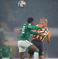 Lincoln City's Timothy Eyoma vies for possession with Hull City's Josh Magennis<br /> <br /> Photographer Chris Vaughan/CameraSport<br /> <br /> EFL Trophy Quarter Final - Hull City v Lincoln City - Tuesday 2nd February 2021 - KCOM Stadium - Kingston upon Hull<br />  <br /> World Copyright © 2021 CameraSport. All rights reserved. 43 Linden Ave. Countesthorpe. Leicester. England. LE8 5PG - Tel: +44 (0) 116 277 4147 - admin@camerasport.com - www.camerasport.com